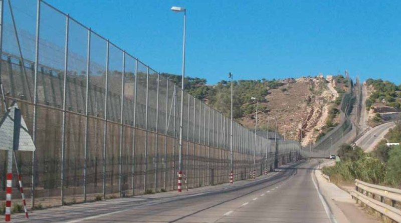 Melilla border fence separating Spain and Morocco.