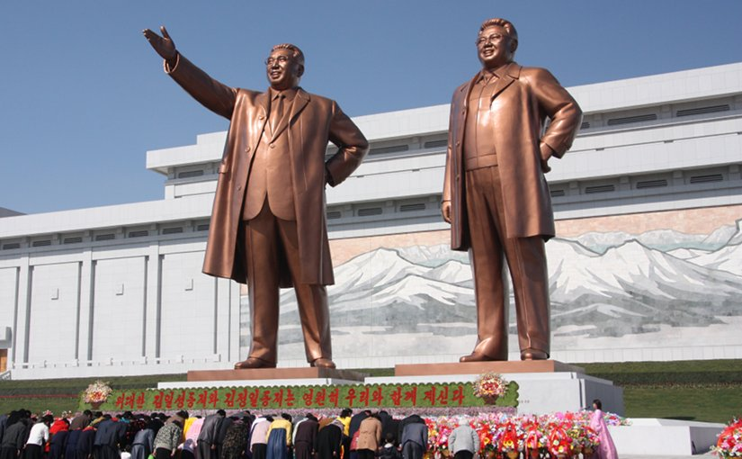 North Koreans bowing to the statues of Kim Il-sung (left) and Kim Jong-il. Photo by J.A. de Roo, Wikipedia Commons.
