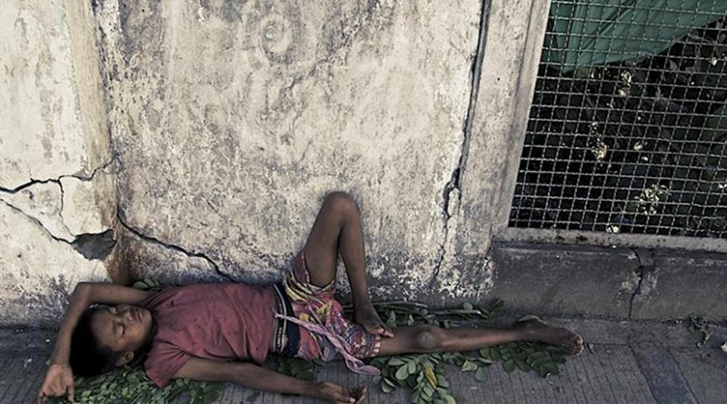 A Rohingya youth sleeps on the street in Burma. Photo Source: Queen Mary, University of London.