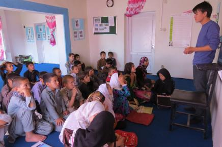 Ali teaching at Street Kids' School. Photo Credit: Voices for Creative Nonviolence