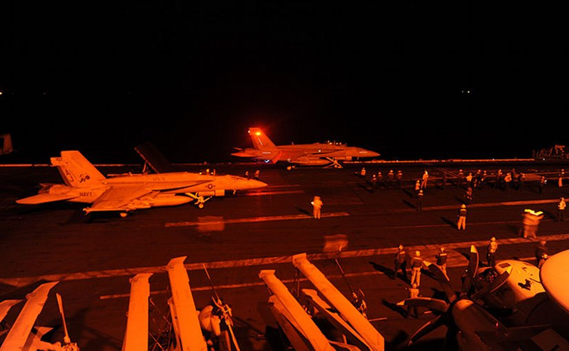 FA-18 Hornets takes off from USS George H.W. Bush to strike ISIL targets in Syria. U.S. Navy photo by Mass Communication Specialist 3rd Class Robert Burck.