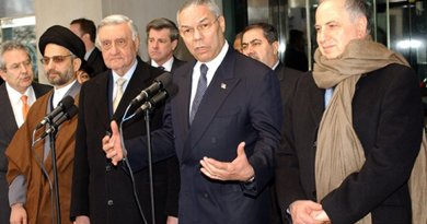 Former U.S. Secretary of State Colin Powell with Members of The Iraqi Governing Council After Their Meeting. Pictured from left to right: Abdul Aziz Al Hakim; Dr. Adnan Pachachi, President of Iraqi Governing Council for January 2004; Ambassador Paul Bremer, U.S. Presidential Envoy to Iraq; Secretary Powell and Dr. Ahmed Chalabi. U.S. State Department photo by Michael Gross.