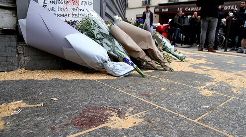 The Le Petit Cambodge restaurant with a makeshift memorial of flowers, the day after the November 2015 attacks in Paris, France. Photo by Maya-Anaïs Yataghène, Wikipedia Commons.