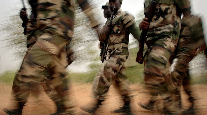 A formation of Nigerien soldiers from the 322nd Parachute Regiment march to a training site where they will learn combat skills from U.S. Army soldiers. U.S. Navy photo by Mass Communication Specialist 1st Class Michael Larson, Wikipedia Commons.
