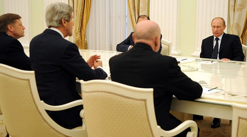 File photo of U.S. Secretary of State John Kerry, accompanied by U.S. Ambassador to Russia Michael McFaul, left, meeting with Russian President Vladimir Putin and Russian Foreign Minister Sergey Lavrov in Moscow. Photo Credit: US State Department, Wikipedia Commons.