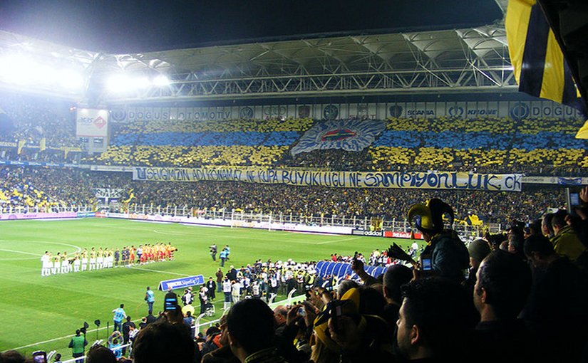 Soccer fans supporting Turkey's Fenerbahçe S.K. Photo by Kızıl Şaman, Wikipedia Commons.