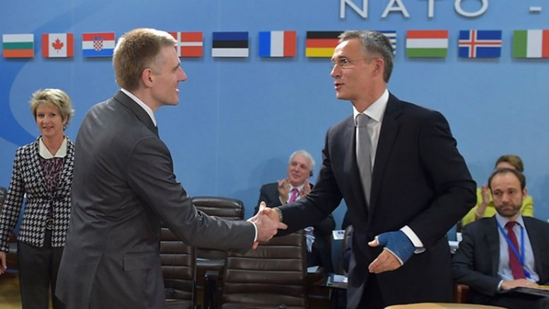 Left to right: Igor Luksic (Deputy Prime Minister and Minister of Foreign Affairs and European Integration, Montenegro) shaking hands with NATO Secretary General Jens Stoltenberg. Photo Credit: NATO.