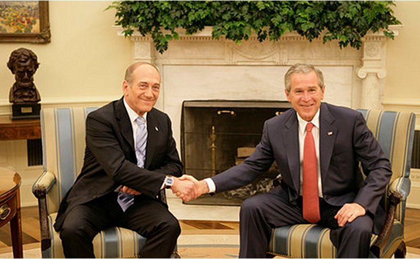 President George W. Bush exchanges handshakes with Prime Minister Ehud Olmert of Israel during their meeting Tuesday, May 23, 2006, in the Oval Office. Photo by Eric Draper, White House, Wikipedia Commons.