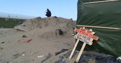 Eviction line in camp in Calais, France. Photo Credit: Maya Evans