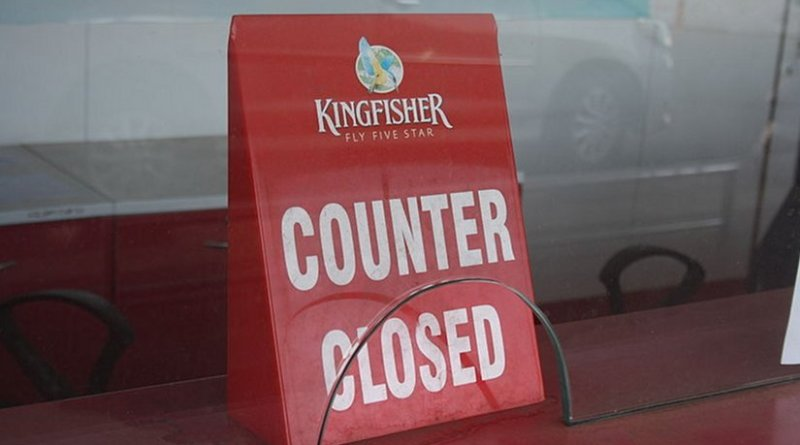 A closed counter after Kingfisher Airlines stopped its service. Photo by Arne Hückelheim, Wikipedia Commons.