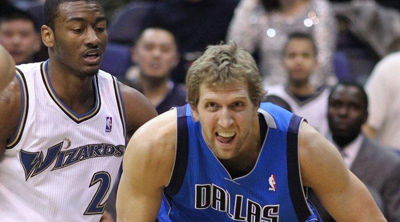 Dirk Nowitzki and John Wall, Wizards v/s Mavericks 02/26/11. Photo by Keith Allison, Wikipedia Commons.