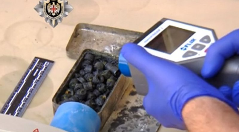 Screengrab from a video footage distributed on April 28, 2016 by the Georgian State Security Service showing investigators checking the radioactivity level of what the security service said was seized 1.6kg of uranium.