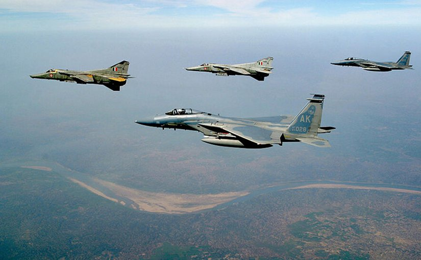 USAF F-15C Eagles from Elmendorf AFB, Alaska and Indian air force MIG-27 Floggers fly together over the Indian landscape.IAF courtesy photo, Wikipedia Commons.