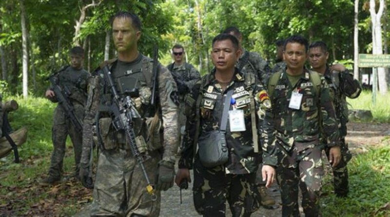 Philippine and U.S. soldiers walk back to the helicopter landing zone after completing Operation Handa Koa during this year's Balikatan exercise in Jamindan, Philippines, April 14, 2016. The U.S. soldiers were assigned to 2nd Battalion, 3rd Infantry Regiment. Navy photo by Petty Officer 2nd Class Jerome D. Johnson