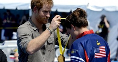 Prince Harry presents a gold medal to U.S. Army Sgt. Elizabeth Marks at the 2016 Invictus Games in Orlando, Fla., May 11, 2016. Marks won the gold medal with a time of 42:67 seconds. Air Force photo by Staff Sgt. Carlin Leslie