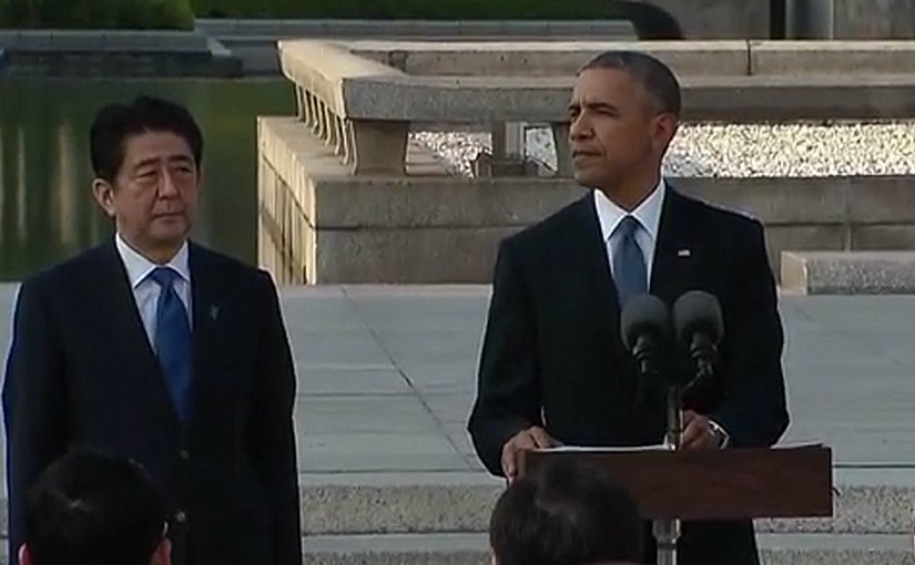 US President Obama delivers remarks at the Hiroshima Peace Memorial in presence of Japan's Prime Minister Shinzō Abe. Photo Credit: Screenshot from White House video.