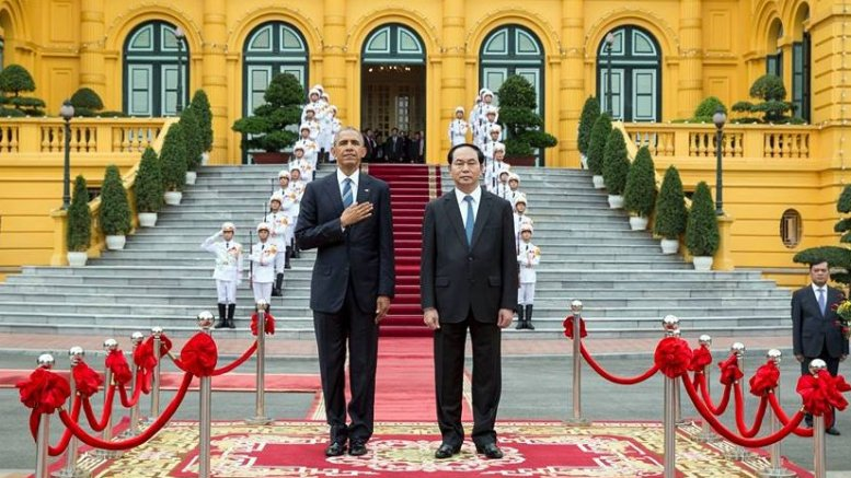US President Barack Obama and Vietnam's President Tran Dai Quang listen to the U.S. national anthem during the arrival ceremony at the Presidential Palace in Hanoi, Vietnam, May 23, 2016. (Official White House Photo by Pete Souza)