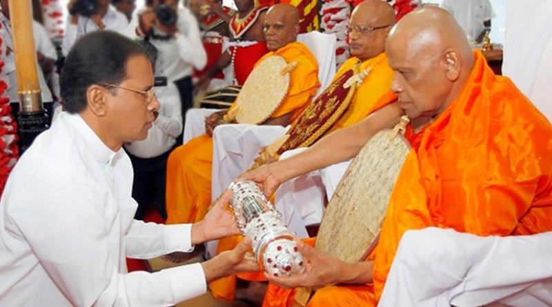 Sri Lanka President Maithripala Sirisena at the state ceremony to offer the Sannas Pathra to the newly appointed Maha Nayaka Most Venerable Varakagoda Sri Gnanasara Thero and the Anu Nayaka Ven Anamaduwe Sri Dhammadassi Thero. Photo Credit: Sri Lanka government.