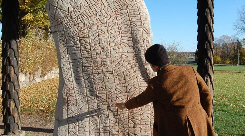 This is Per Holmberg, researcher at University of Gothenburg with the Rök Runestone. Credit University of Gothenburg