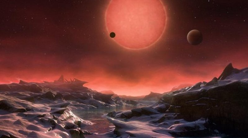 This artist's impression shows an imagined view from the surface one of the three planets orbiting an ultracool dwarf star just 40 light-years from Earth that were discovered using the TRAPPIST telescope at ESO's La Silla Observatory. These worlds have sizes and temperatures similar to those of Venus and Earth and are the best targets found so far for the search for life outside the solar system. They are the first planets ever discovered around such a tiny and dim star. In this view one of the inner planets is seen in transit across the disc of its tiny and dim parent star. Credit ESO/M. Kornmesser