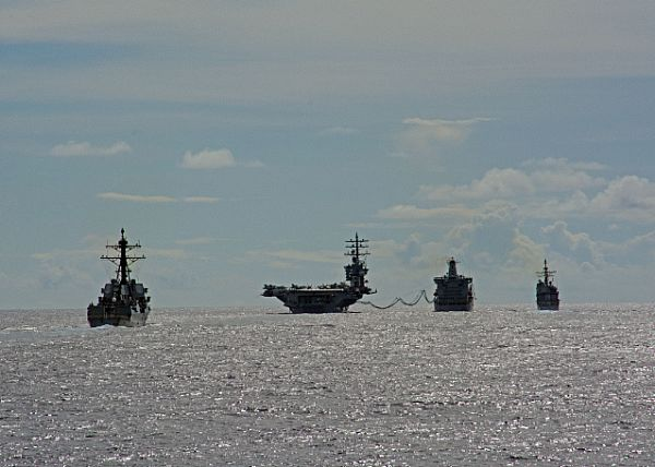 Ships assigned to the Eisenhower Carrier Strike Group (Ike CSG) conduct a replenishment-at-sea with the Military Sealift Command fleet replenishment oiler USNS Big Horn (T-AO 198). Ike CSG is deployed to the U.S. 5th and 6th Fleet areas of responsibility in support of maritime security operations and theater security cooperation efforts. The Ike CSG includes USS Dwight D. Eisenhower (CVN 69) (Ike), Carrier Air Wing (CVW) 3, Destroyer Squadron (DESRON) 26 and ships USS San Jacinto (CG 56), USS Monterey (CG 61), USS Stout (DDG 55), USS Roosevelt (DDG 80), USS Nitze (DDG 94) and USS Mason (DDG 87). (U.S. Navy photo by Seaman Janweb B. Lagazo/Released)