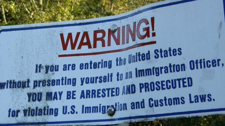 Sign on US border. Photo by Makaristos, Wikipedia Commons.