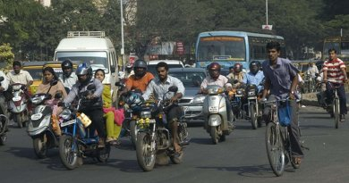 Bicycle and motorcycle riders in India.