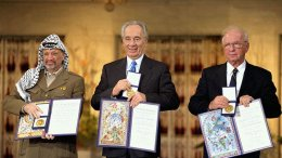 The Nobel Peace Prize laureates for 1994 in Oslo. From left to right: PLO Chairman Yasser Arafat, Israeli Foreign Minister Shimon Peres, Israeli Prime Minister Yitzhak Rabin. Credit: Saar Yaacov, GPO - Government Press Office, Israel, Wikimedia Commons