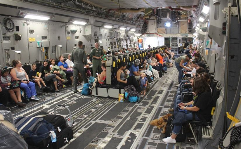 Families from Naval Station Guantanamo Bay, Cuba, settle into their seats aboard a Boeing C-17A Globemaster III aircraft for evacuation ahead of Hurricane Matthew, Oct. 2, 2016. About 700 spouses, children and pets were evacuated to Naval Air Station Pensacola, Fla., until the hurricane passes. Base tenant commands and 4,800 personnel remain to continue preparations for the storm. Hurricane condition of Readiness 2 was set base wide in preparation for destructive winds within 24 hours. Army photo by Capt. Frederick H. Agee