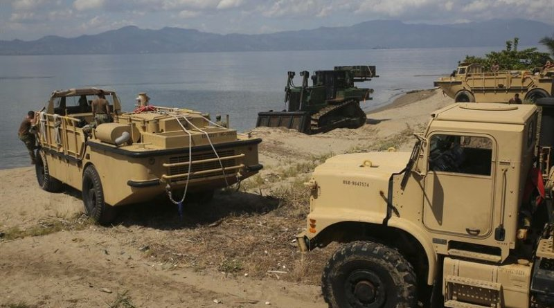 Marines with Special Purpose Marine Air-Ground Task Force Southern Command and sailors with the USS Oak Hill disembark gear and vehicles at Puerto Castilla, Honduras, June 15, 2016. The Marines and sailors unloaded all their vehicles and gear necessary for construction projects in Honduras with the assistance of the Honduran military. U.S. Marines and sailors assigned to the task force participated in engineering projects, security cooperation and disaster relief preparation in Belize, El Salvador, Guatemala and Honduras. Marine Corps photo by Cpl. Ian Ferro