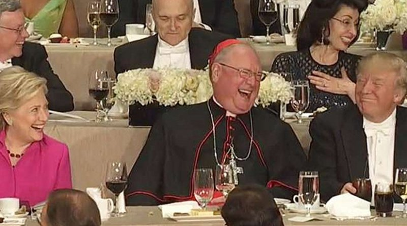 Screenshot from 2016 Al Smith Dinner, with Hillary Clinton, Cardinal Timothy Dolan, and Donald Trump. Screenshot NY Times YouTube video.