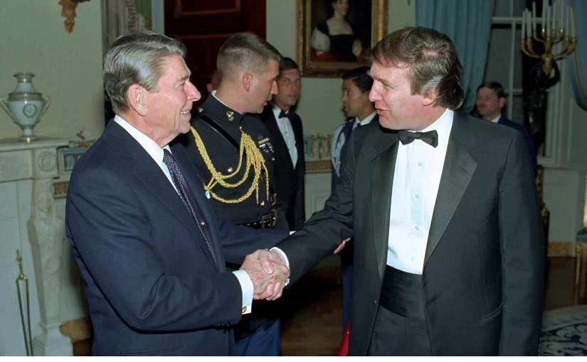 Donald Trump meet US President Ronald Reagon in 1987. Photo Ronald Reagan Presidential Library, White House photographer, Wikipedia Commons.