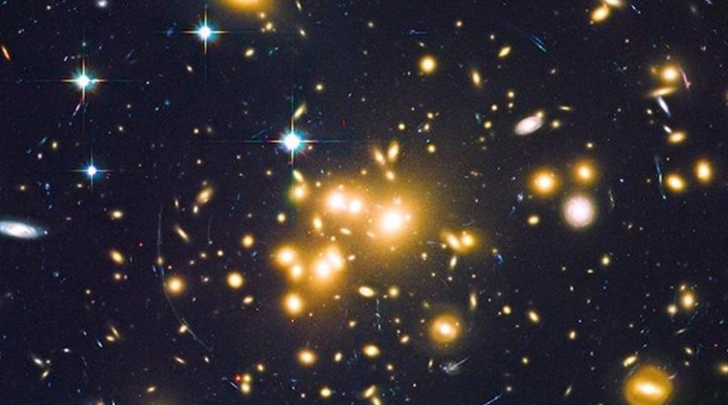 Massive cluster of galaxies Abell 1689 creates a strong gravitational effect on background and older galaxies, seen as arcs of light. Credit NASA, ESA, B. Siana, and A. Alavi