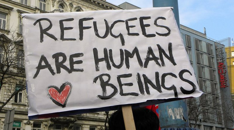 Pro-refugee sign. Photo by Haeferl, Wikimedia Commons.