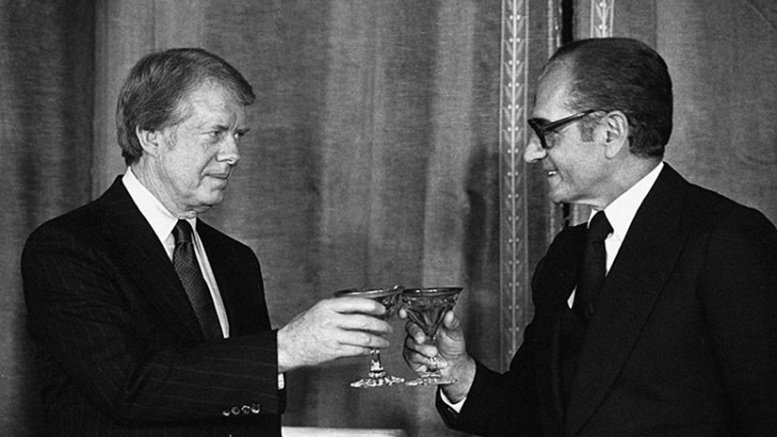 US President Jimmy Carter and Iran's Shah Mohammad Reza Pahlavi in formal dinner in the Niavaran Palace in Tehran, Iran, on 31 December 1977. Source: Wikipedia Commons.