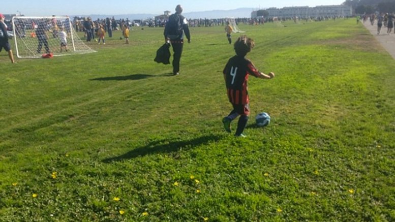 Child playing soccer.
