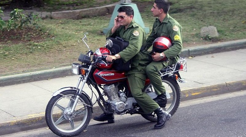 Soldiers of Fuerzas Armadas Revolucionarias on a motorbike. Photo by Bogdan, Wikipedia Commons.