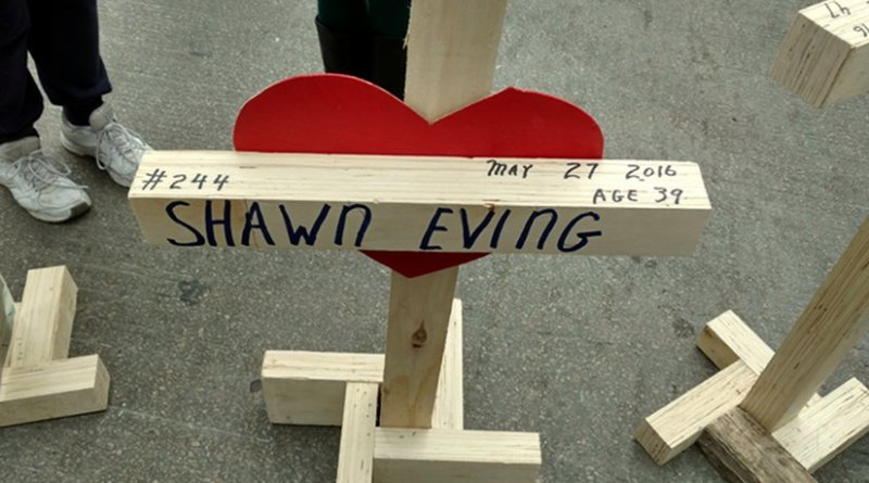 One of more than 750 crosses carried in a Chicago rally commemorating homicide victims on New Year's Eve. Photo credit: Ed Juillard.