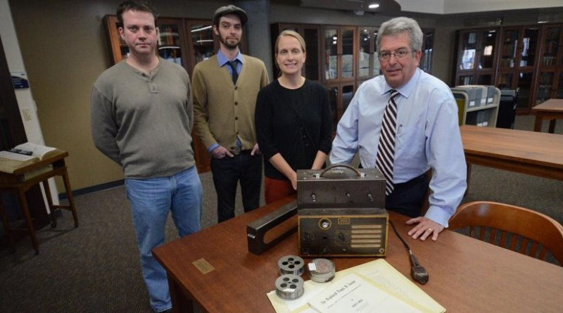 Here with a wire recorder and wire spools that hold the voices of Jewish concentration camp survivors are, from left, James Newhall, who redesigned a useable recorder, along with the Cummings Center's Jon Endres, Dr. Jodi Kearns and Dr. David Baker. Credit The University of Akron