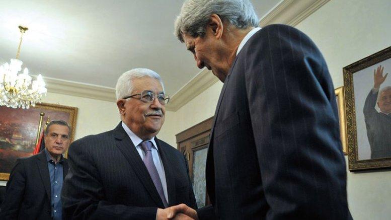 Palestinian Authority President Mahmud Abbas greets U.S. Secretary of State John Kerry as he arrives for meeting in Amman, Jordan, June 2013 (State Department)