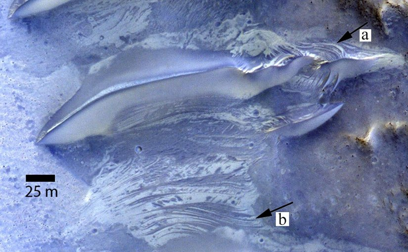 a) Exposure of putative crossbeds on windward slope of dunes on Mars b) Interdune strata exposed in planform showing contrasting albedo and crosscutting relationships similar to that exposed in the dune. Subset of false-colour HiRISE image ESP_013319_1685. The Infrared, red and blue bands are displayed as red, green and blue. Credit Dr Mary Bourke (Trinity College Dublin).