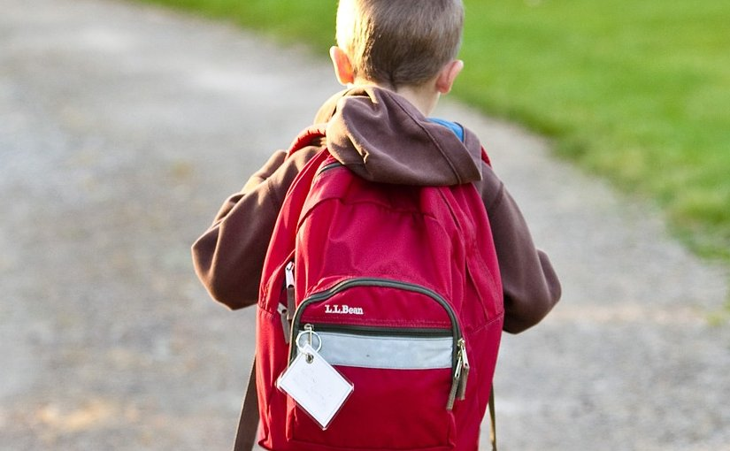 A child going to school with his backpack