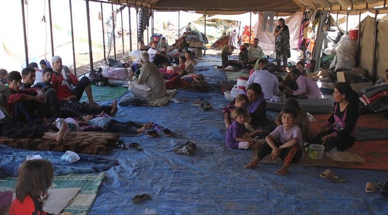 Yazidi refugees escaping from the Islamic State receiving support from the International Rescue Committee. Photo by Rachel Unkovic/International Rescue Committee, Wikimedia Commons.