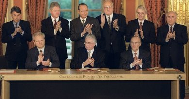 President of Serbia Milosevic, President of Croatia Tudjman, President of Bosnia Izetbegovic signing the Dayton Agreement. Photo Credit: NATO, Wikipedia Commons.