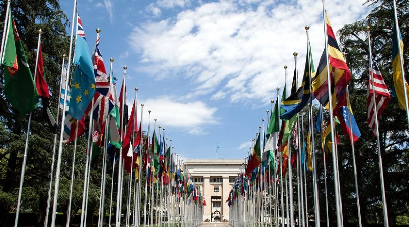Flags flying at the Allée des Nations in front of the Palace of Nations (United Nations Office at Geneva). Photo by Tom Page, Wikimedia Commons.