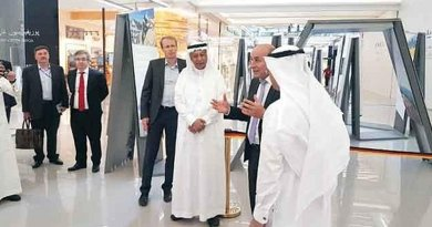 German Ambassador Dieter W. Haller, second from right, meets with guests at exhibition. Photo Credit: Arab News.