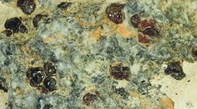 The fragment of the metamorphic rock eclogite in which the garnet that encased the ferric-iron-rich majorite sample was found in Northern China. Credit Image is courtesy of Yingwei Fei.