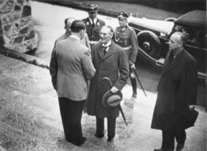Neville Chamberlain shaking hands with Adolf Hitler in 1938. (Source: German Federal Archive)