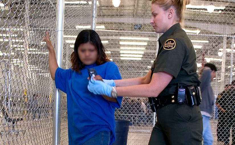 CBP Border Patrol agent conducts a pat down of a female Mexican being placed in a holding facility. Photo Credit: Gerald L. Nino, CBP, U.S. Dept. of Homeland Security