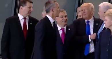 US President Donald Trump pushes past Montenegro's Prime Minister Dusko Markovic. Screenshot from Pool Photo.
